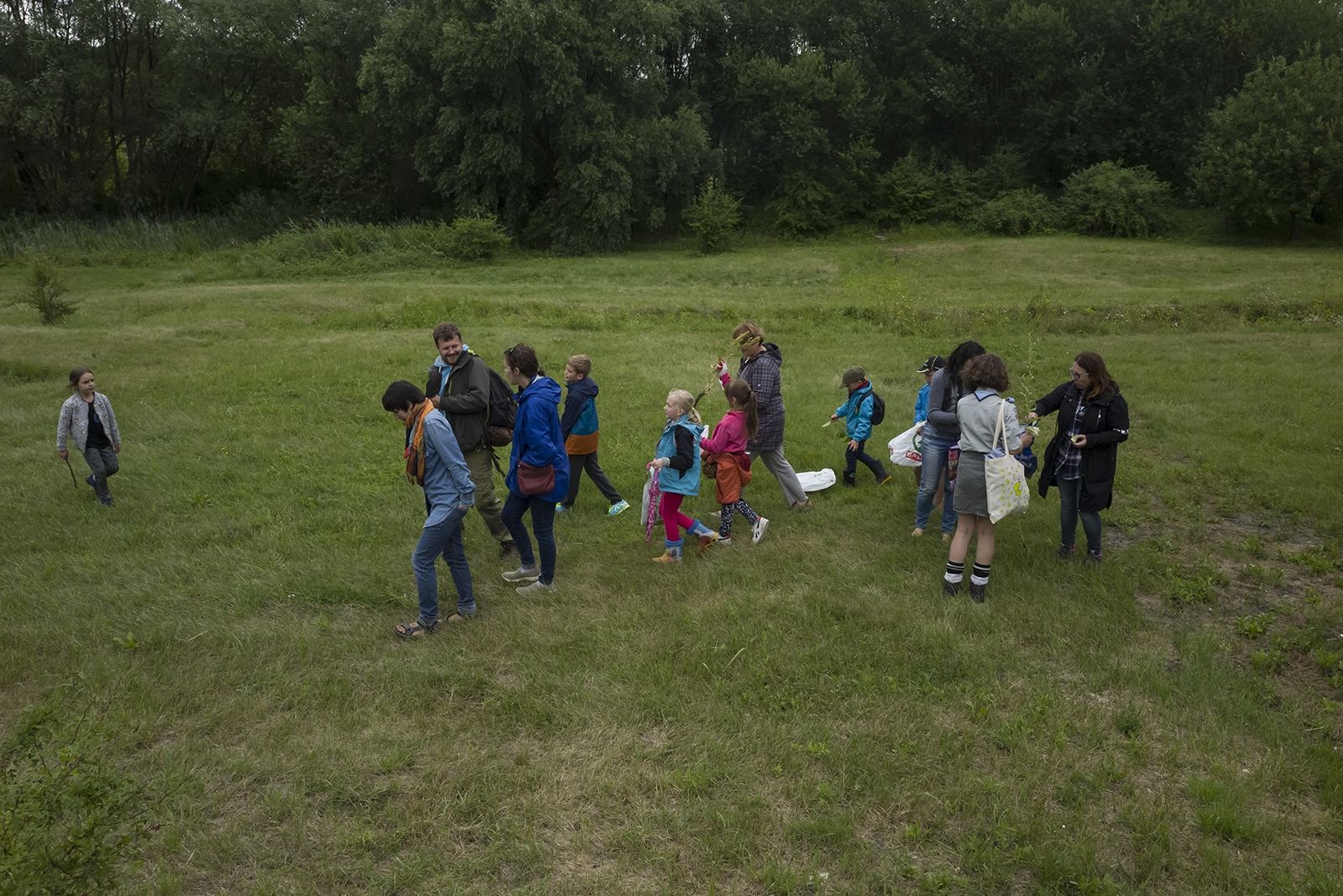 Local children gathering plants for the Medicinal Plant of Płaszów garden.